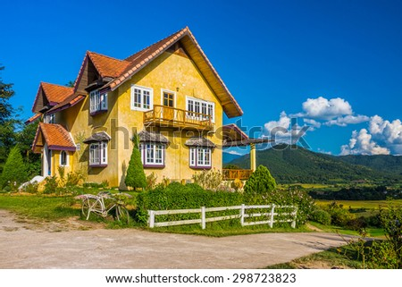Vintage European style of yellow house in countryside of Mae Hong Son province, Northern Thailand - stock photo