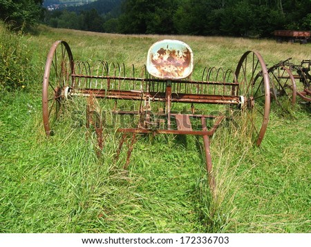 Vintage farm equipment, horse-drawn rake - stock photo