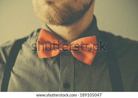 Vintage fashion man with red tie and beard - stock photo