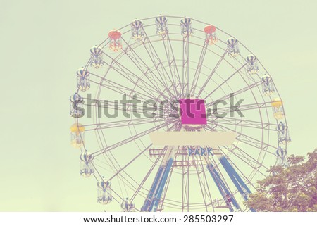 Vintage Ferris Wheel on background blue Sky - stock photo