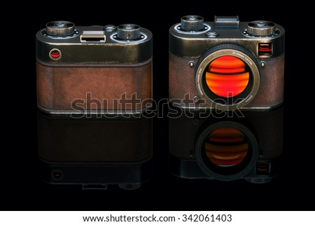 Vintage film photo camera in black studio. 3d render - stock photo