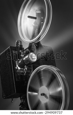 Vintage film projector in black and white - stock photo