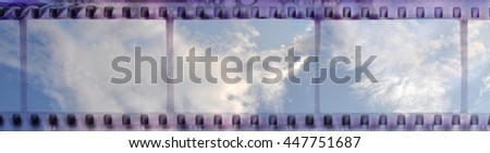 Vintage film strip frame with clear cloudy sky - stock photo