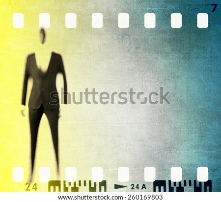 Vintage film strip frame with stylized male figure - stock photo