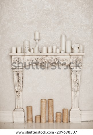 Vintage fire place with candle - stock photo