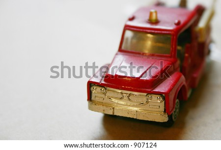 vintage firetruck model toy - stock photo