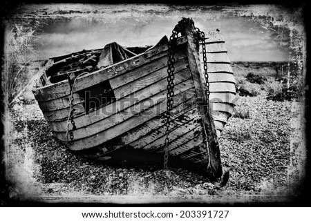 Vintage fishing boat. An old distressed image of a old fishing boat in black and white. - stock photo