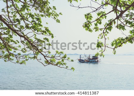 Vintage fishing boat coming back to the harbor - stock photo
