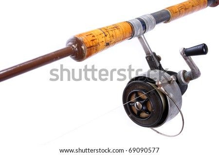 Vintage fishing rod with reel. - stock photo