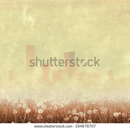Vintage foggy city skyline with dandelion - stock photo