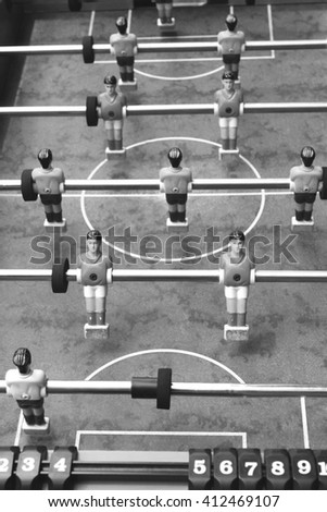 Vintage foosball, black and white photo - stock photo