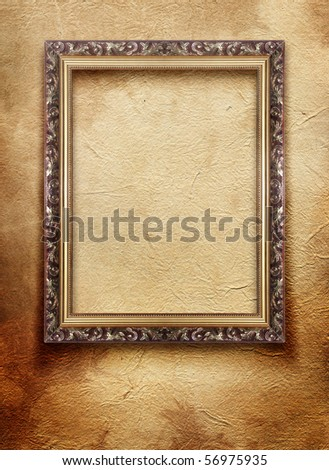 vintage frame on old grunge wall - stock photo
