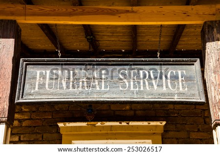 Vintage Funeral Service cartel made of wood. Good for concepts. - stock photo