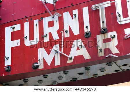 vintage furniture sign in disrepair - stock photo