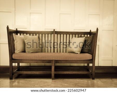 Vintage furniture sofa with pillows. Vintage furniture set. - stock photo