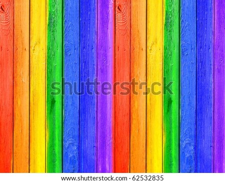 Vintage Gallery: Grunge wooden background - rainbow paints on big old fence - stock photo