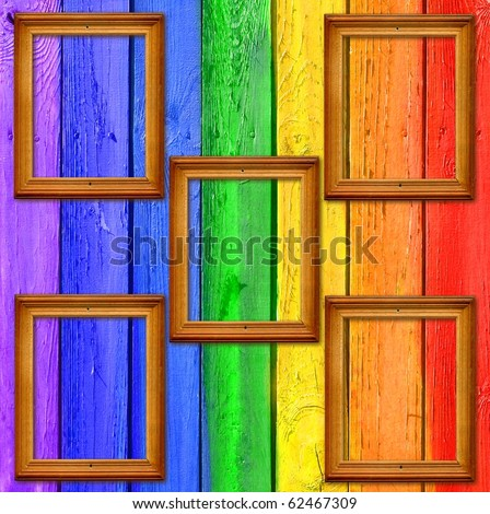 Vintage Gallery: Rainbow scrapbooking background - painted fence with five wooden frames - stock photo