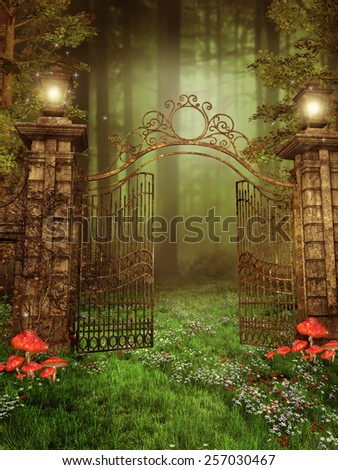 Vintage gate with lamps on a meadow with spring flowers - stock photo