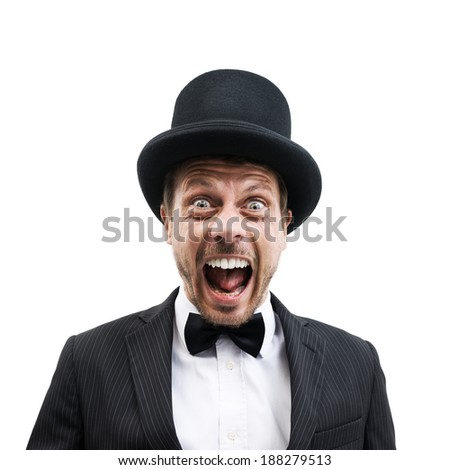 Vintage gentleman with bowler hat and bow tie screaming at camera. - stock photo