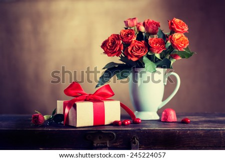 Vintage gift box and flowers on the old table, Valentine's Day - stock photo