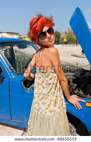 Vintage girl posing in front of the car summer day - stock photo