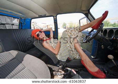 Vintage girl posing inside the car - stock photo