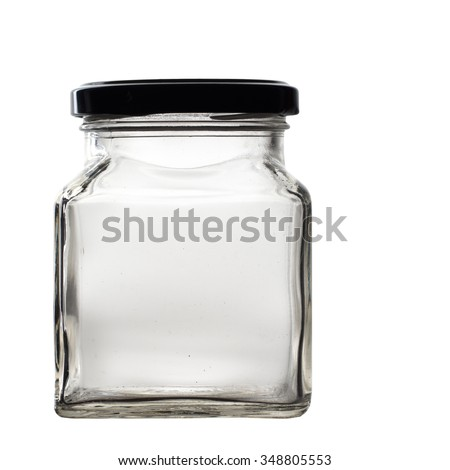 Vintage glass jar, square, with black lid. Empty. Isolated on white. - stock photo