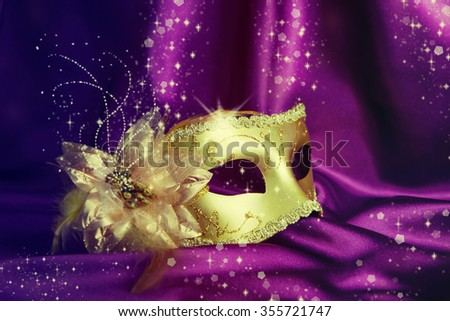Vintage gold carnival mask on a dark background. - stock photo