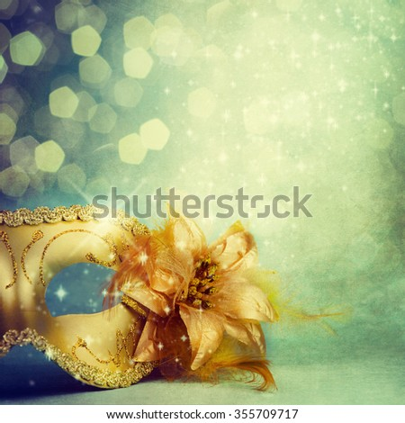Vintage gold carnival mask on a turquoise background. - stock photo