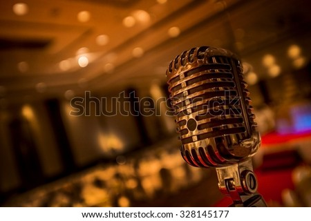 Vintage gold microphone  in party - stock photo