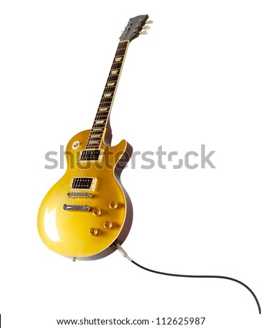 Vintage Gold top electric solid body guitar plugged in, isolated on white. Single cutaway. - stock photo