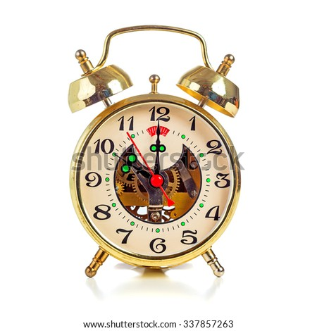 Vintage golden alarm clock on white background showing ten o'clock - stock photo