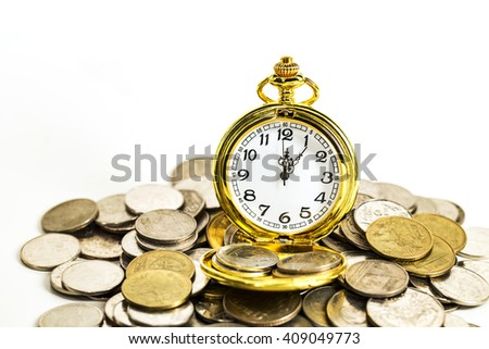 vintage golden pocket watch with stack coins isolated on white background.time money concept.  - stock photo