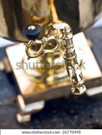 Vintage golden Samovar detail, shallow DOF - stock photo