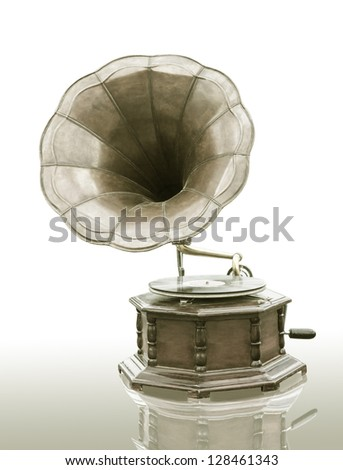 Vintage Gramophone with disc isolated on grunge background - stock photo