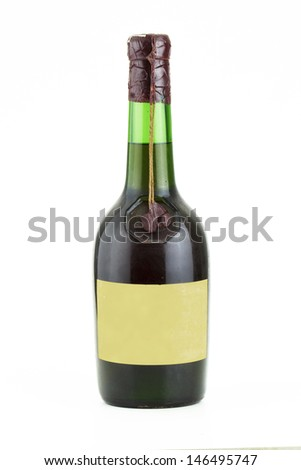 vintage green glass bottle with liquor - stock photo