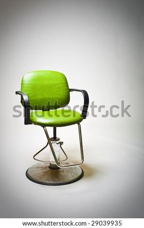 Vintage green vinyl covered barber shop chair. - stock photo