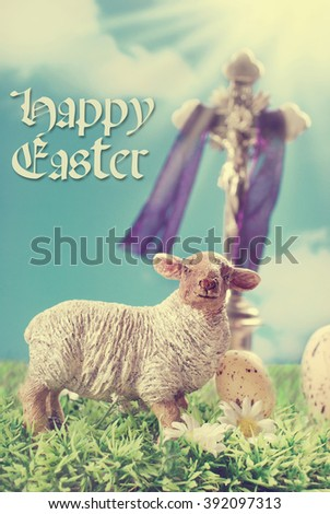 vintage greeting card with Jesus Christ on the cross and lamb figurine against blue sky as symbol of easter  - stock photo