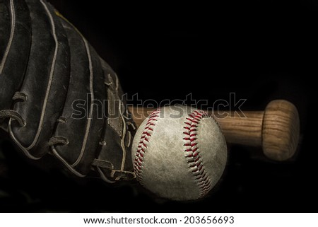 vintage grunge effect low key baseball bat, mitt glove and ball with space for text - stock photo