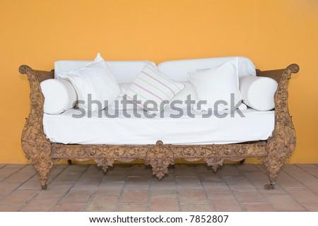 Vintage grunge iron sofa with white cushion - stock photo
