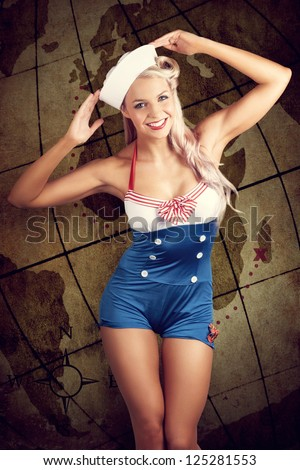 Vintage Grunge Photo Of A Young Woman In Sailor Hat And Pinup Outfit Standing In Front Of An Old Travel Map Illustration - stock photo