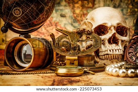 Vintage grunge still life. Vintage items on ancient map. - stock photo