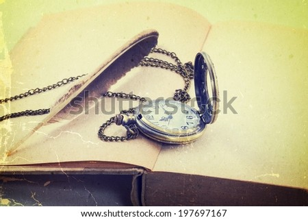 Vintage grunge  with antique pocket watch, and old book  ,quill   - stock photo