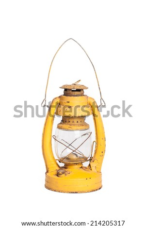 Vintage grunge yellow rusty kerosene lamp on isolated white background - stock photo