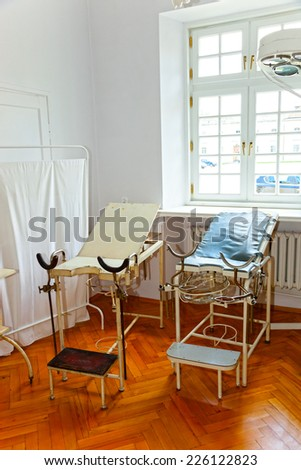 Vintage gynecological chair and equipment of the last century - stock photo