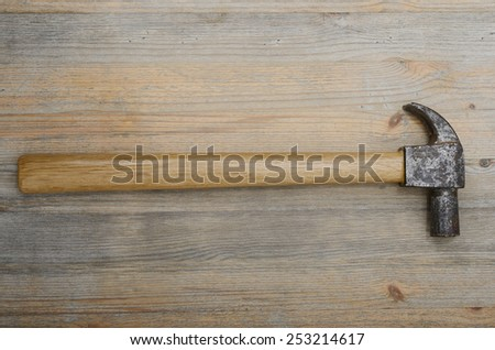 vintage hammer on a wooden surface, horizontal - stock photo