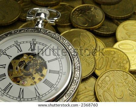 vintage hand watch and euro coins time is money - stock photo