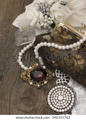 vintage handbag in the retro arrangement - stock photo