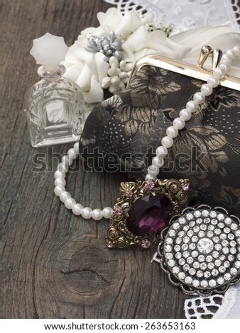 vintage handbag with accessories  - stock photo
