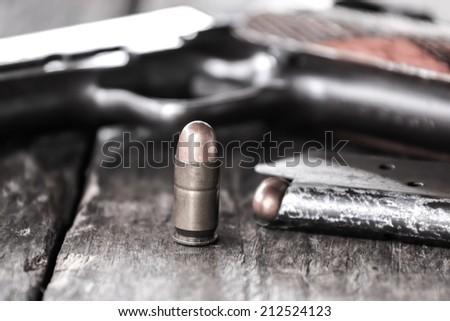vintage handgun bullets - stock photo